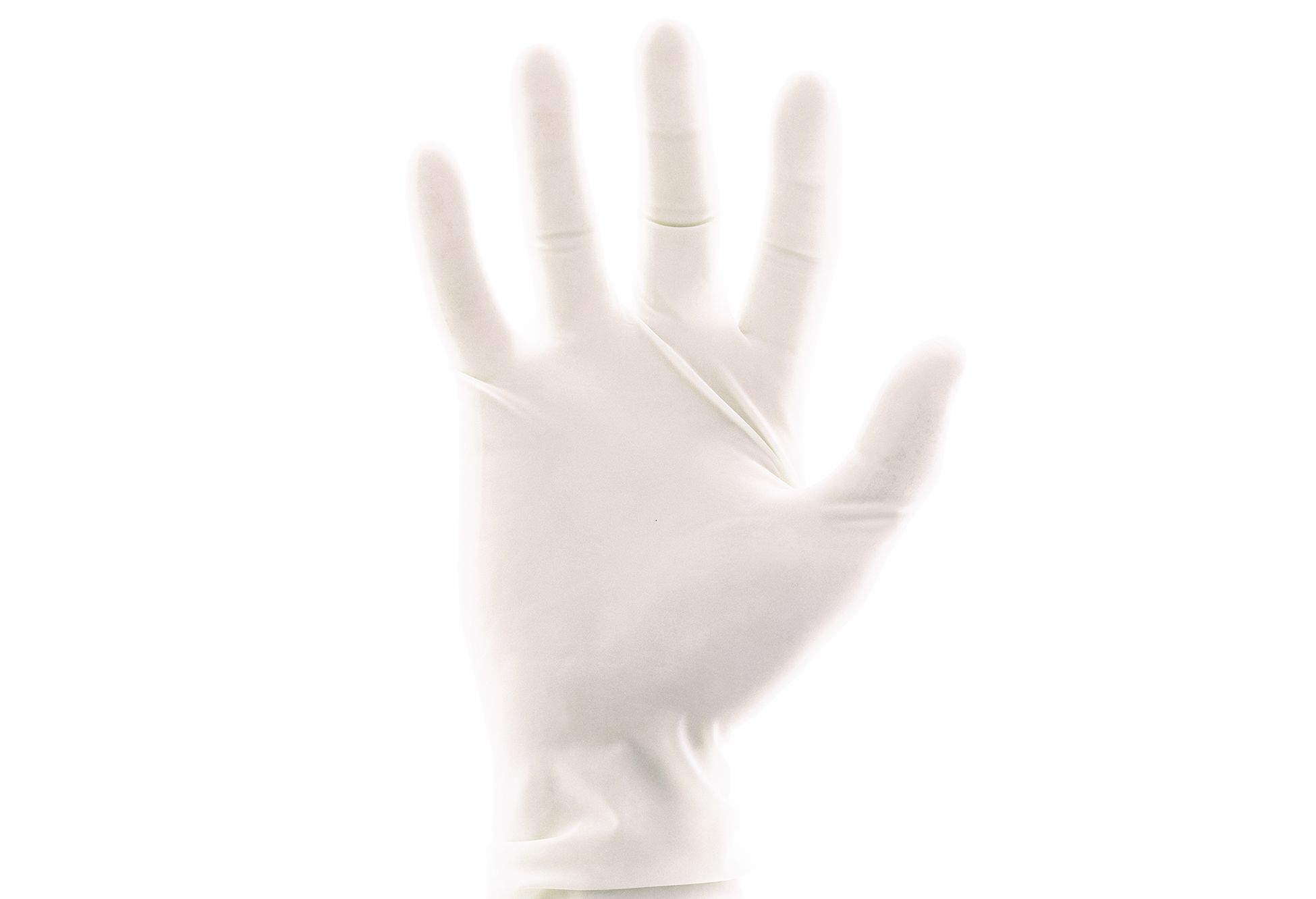 A white medical glove on a white background.