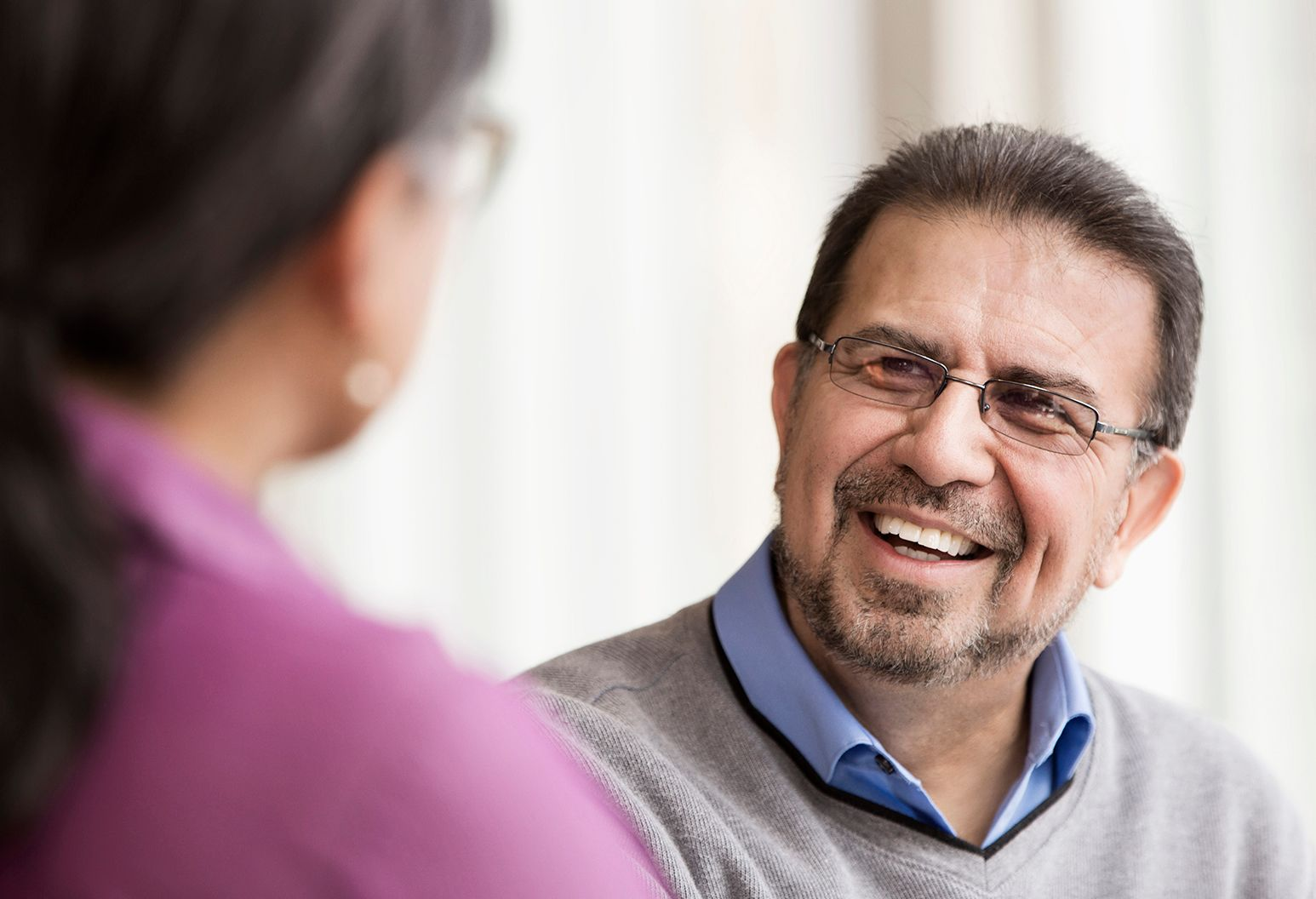 Close up of man talking to a woman in a support group