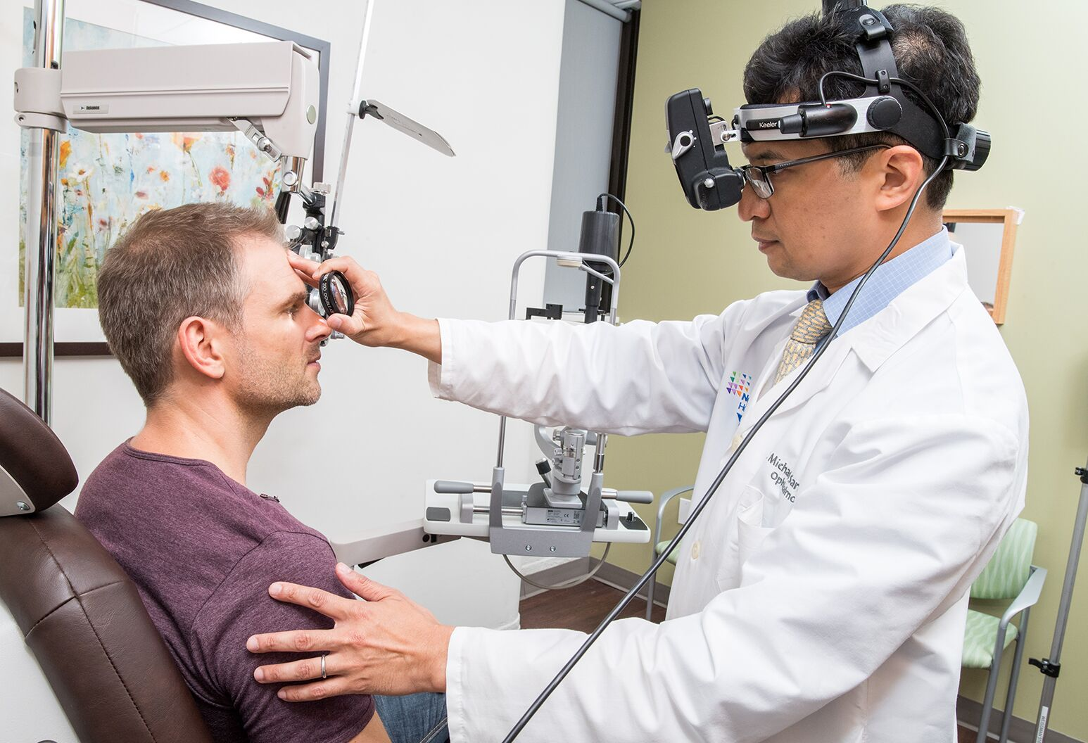 Patient getting their eyes examined.