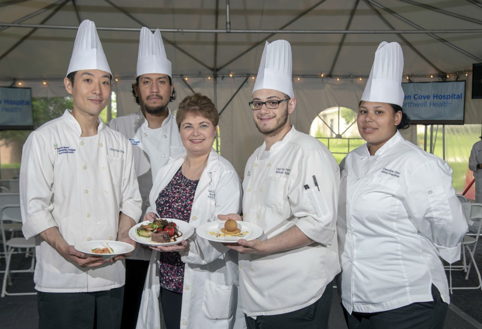 North Shore University Hospital's Gyalsten Ethenpa, Paul Choe, Nicholas Rappa, Janisa Freycinet and Laura Zelenka Dufresne, RD, with their winning dishes from the 2019 Northwell Health Ultimate Chef Challenge.