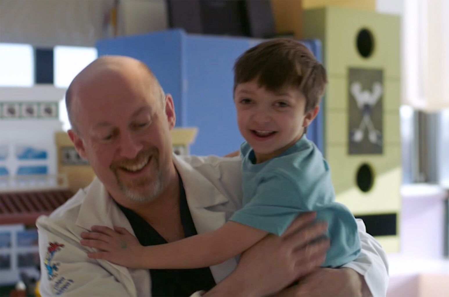 Mark Mittler, MD, holds a boy