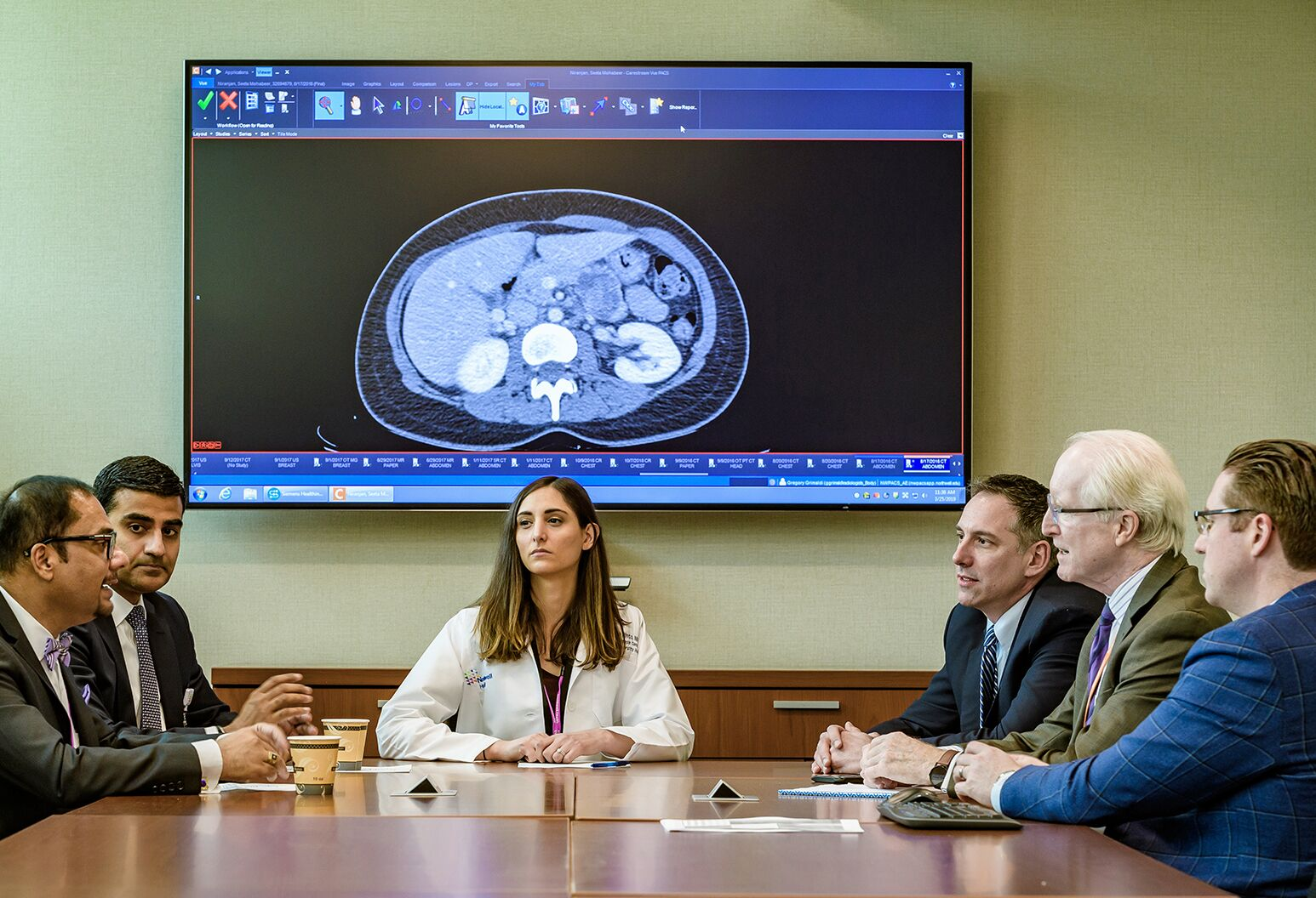 Matthew Weiss, MD, (far right) and Northwell Health Cancer Institute leaders discuss a new case.