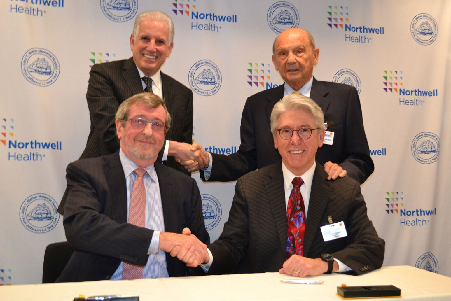 Michael Dowling, Mark Claster with Mather Hospital leadership as the hospital officially became a member of Northwell Health