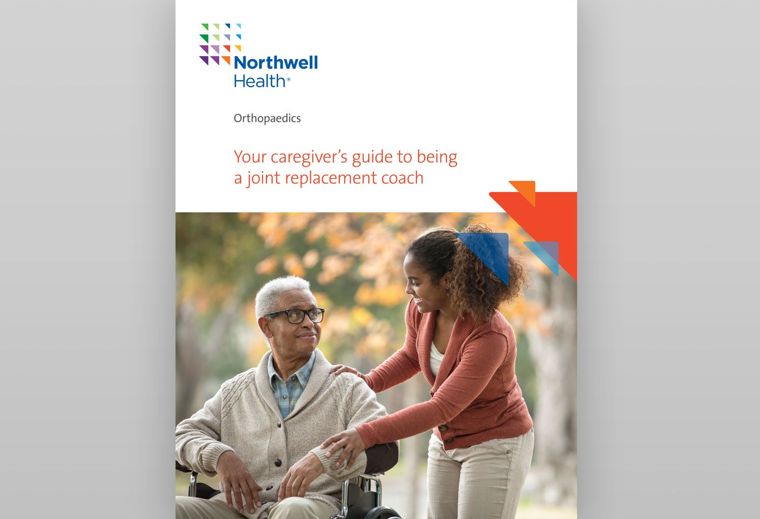 On the cover of a booklet about tips for caregivers, there is an elderly man sitting in a wheel chair wearing glasses and a tan sweater. A young woman is standing next to him and holding his arm. They're looking at each other, smiling.