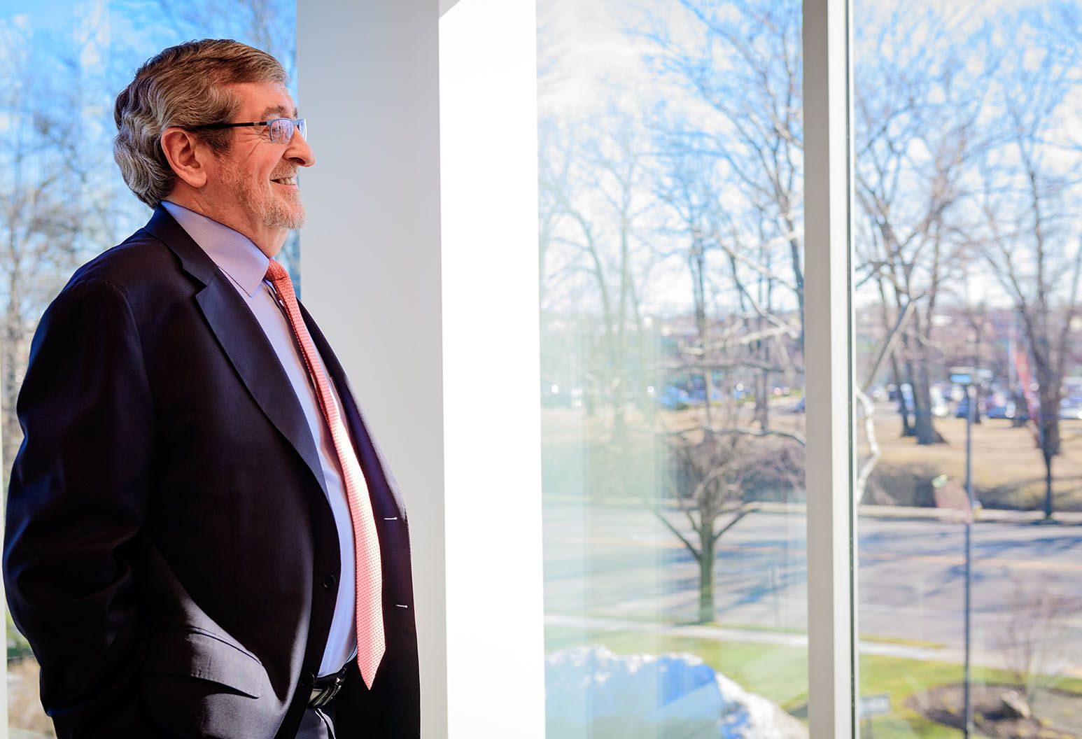 Michael Dowling, President and CEO looks out into the distance with a smile on his face