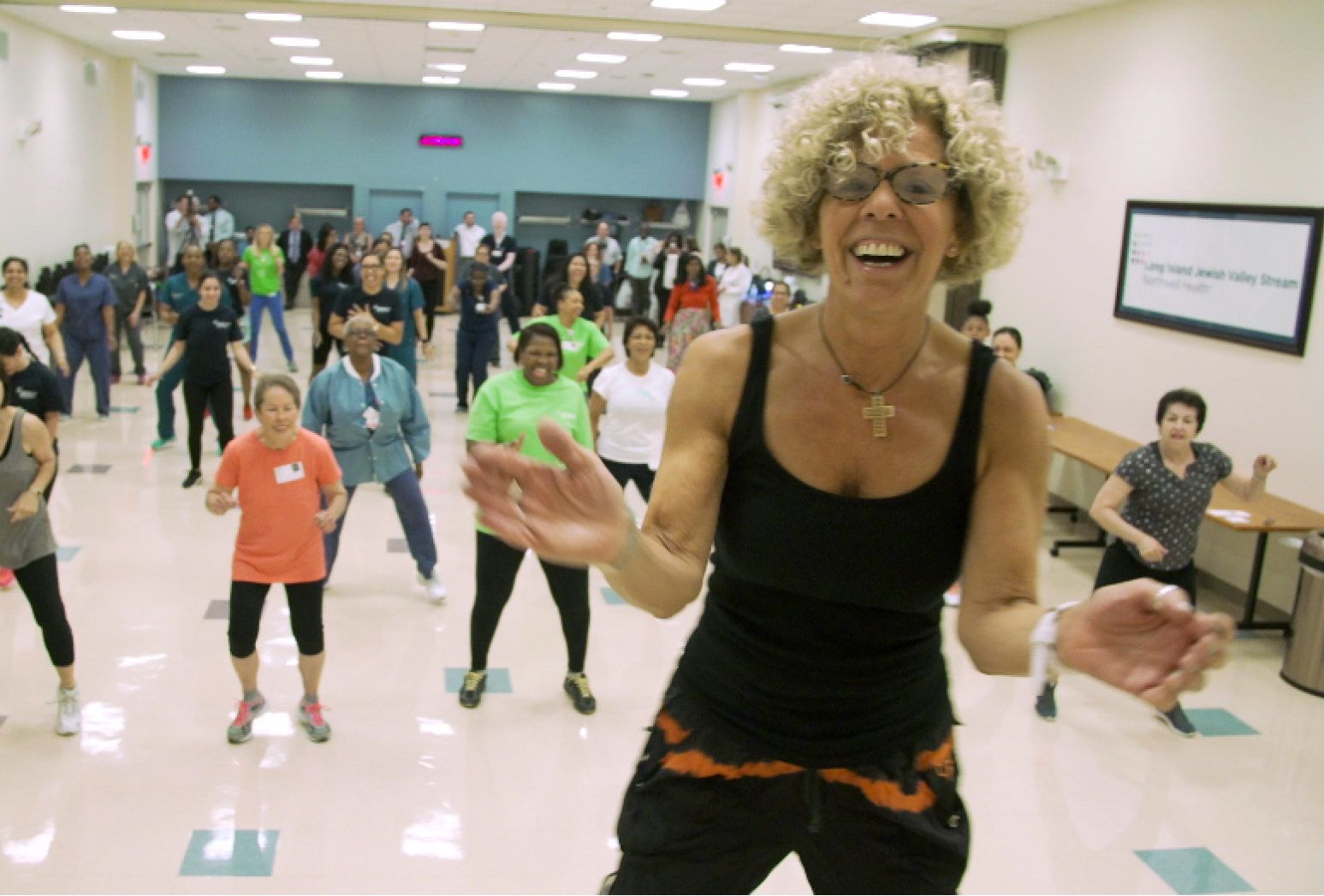 Margaret Tapogna leads a crowd at Long Island Jewish Valley Stream Hospital during her Zumba class.