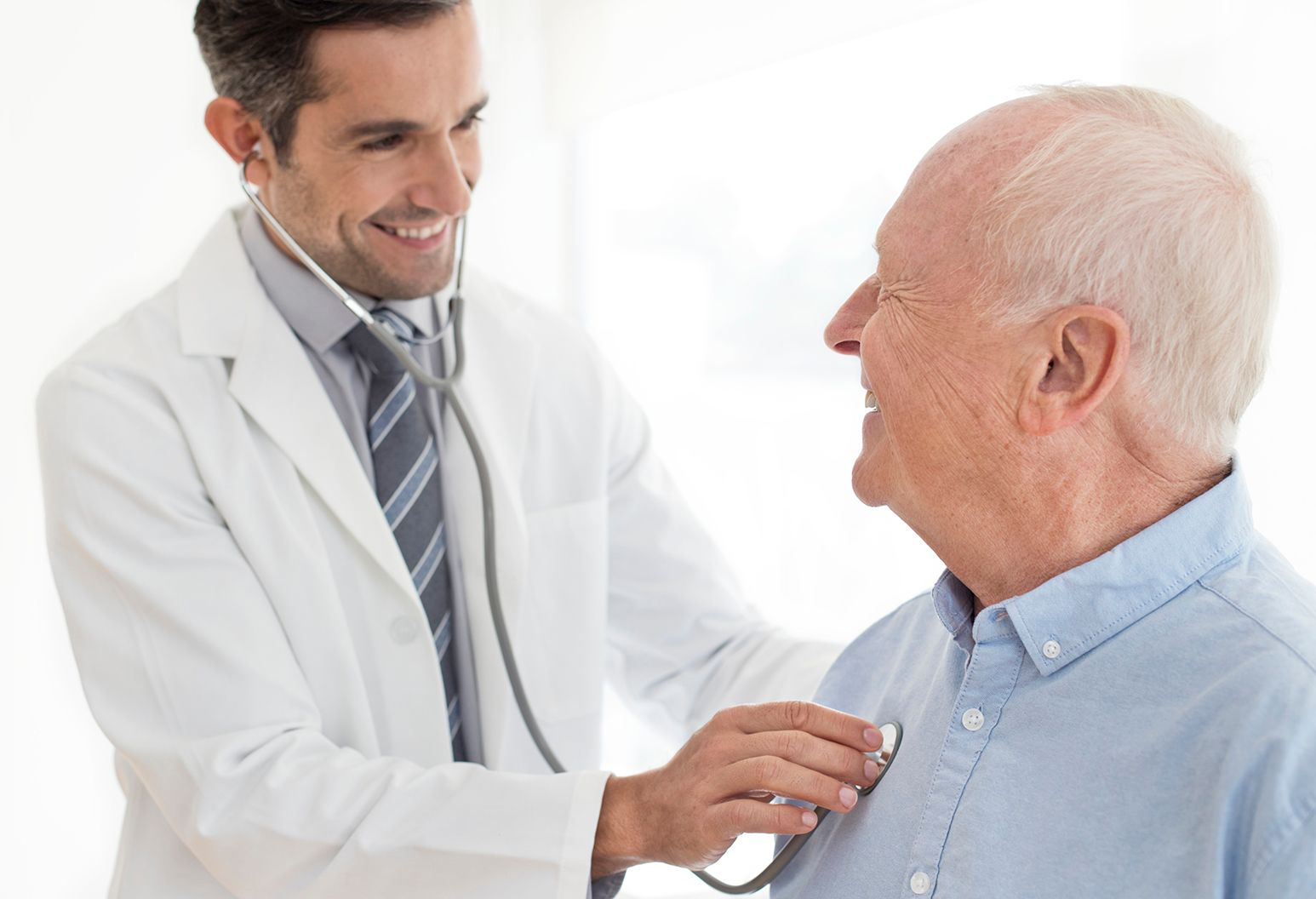 Male doctor examining senior patient