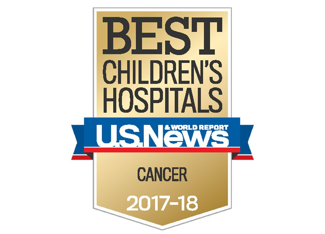 "A brown badge and blue and red ribbon that reads ""Best Children's Hospitals. U.S. News and World Report. Cancer. 2017-18"""