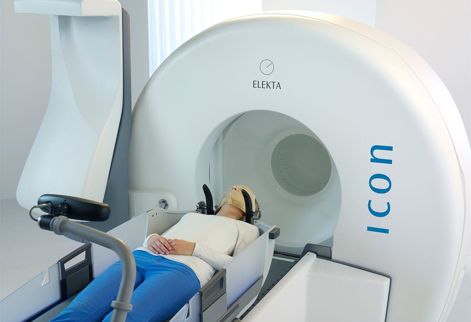 A woman laying down on a Gamma Knife Icon machine