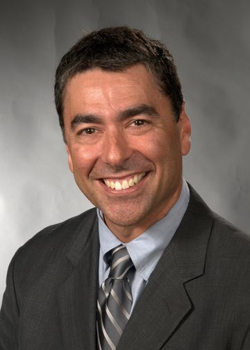 David Langer, MD, wearing a grey tie