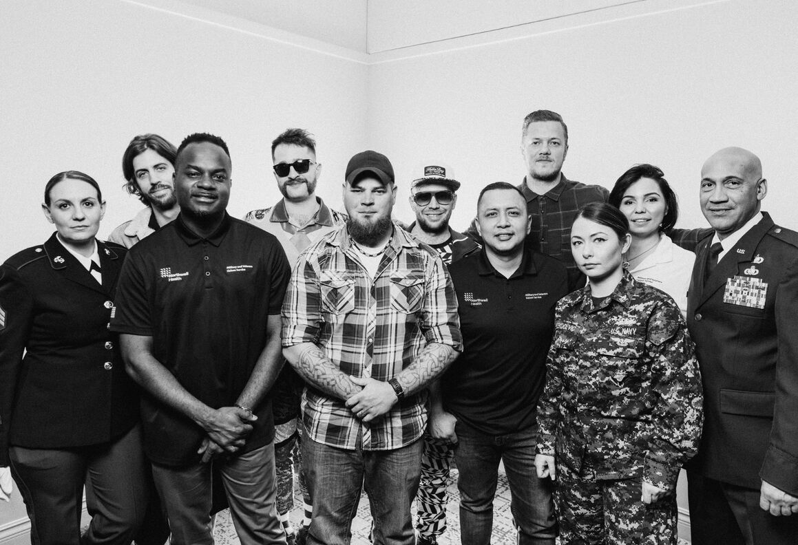Members of Imagine Dragons with veterans and Northwell staff