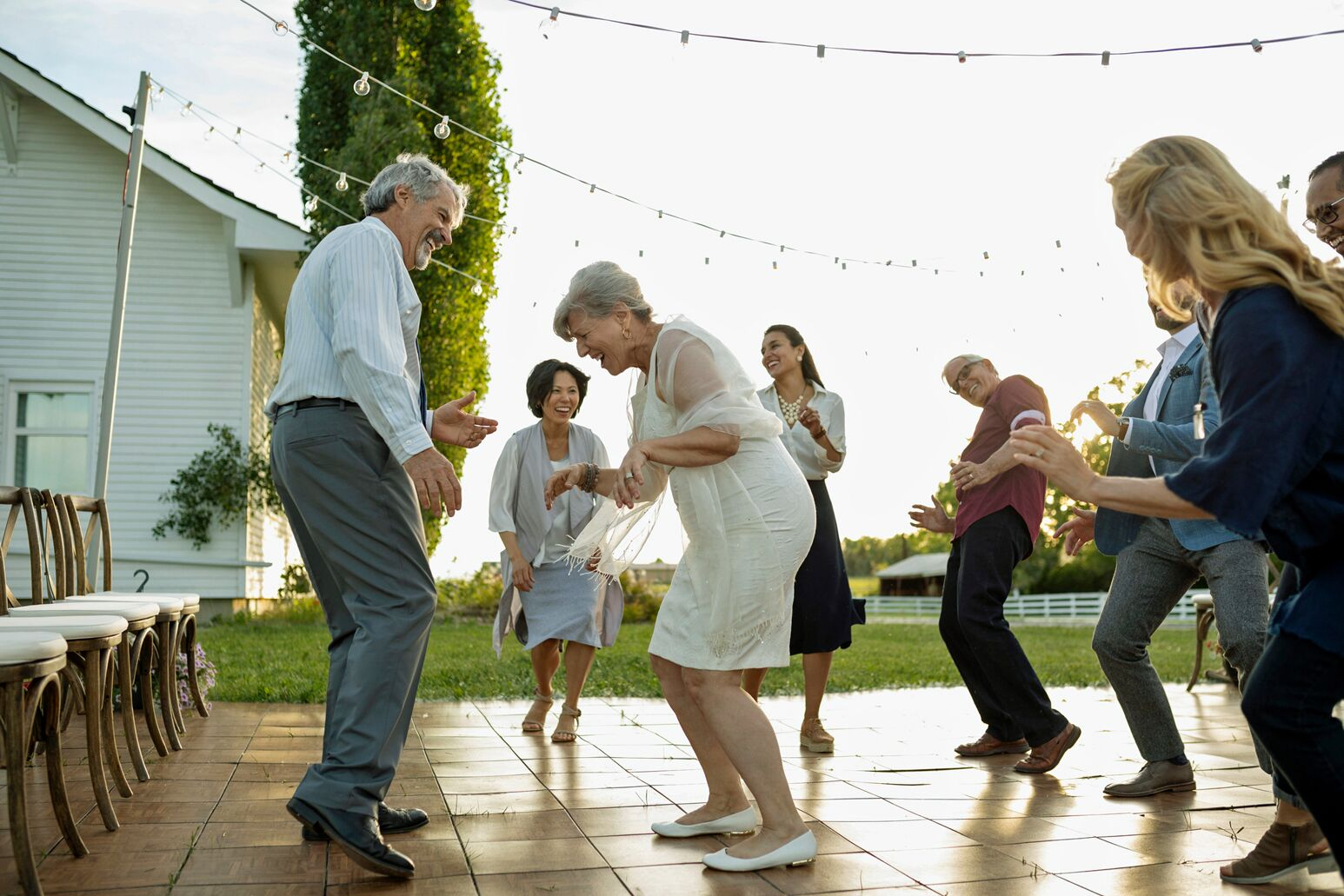 Elderly people dance during a party. William Healy, MD, explains as Baby Boomers and the population ages, it increases the need for advanced total joint replacements.