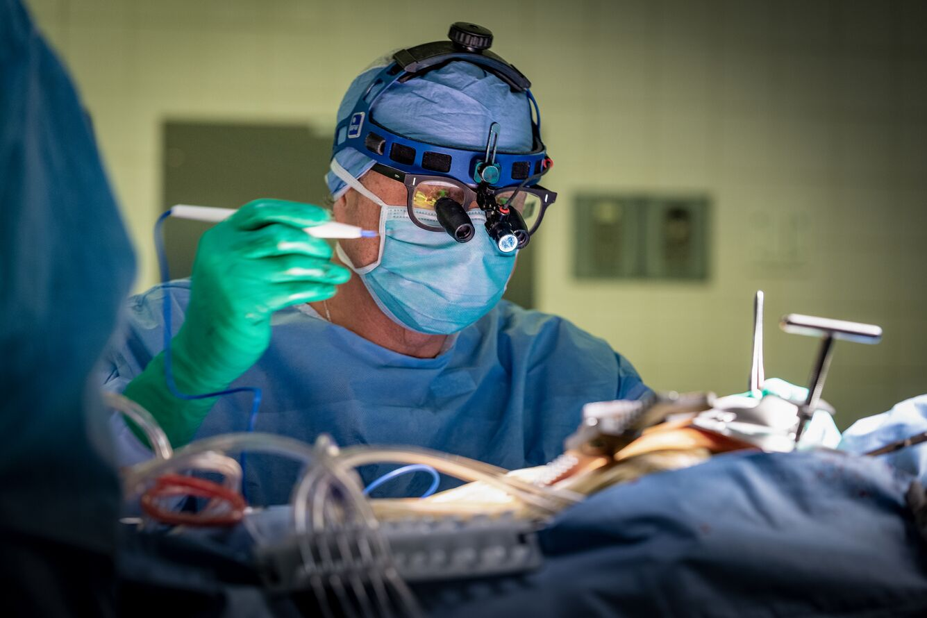 A cardiac surgeon operates