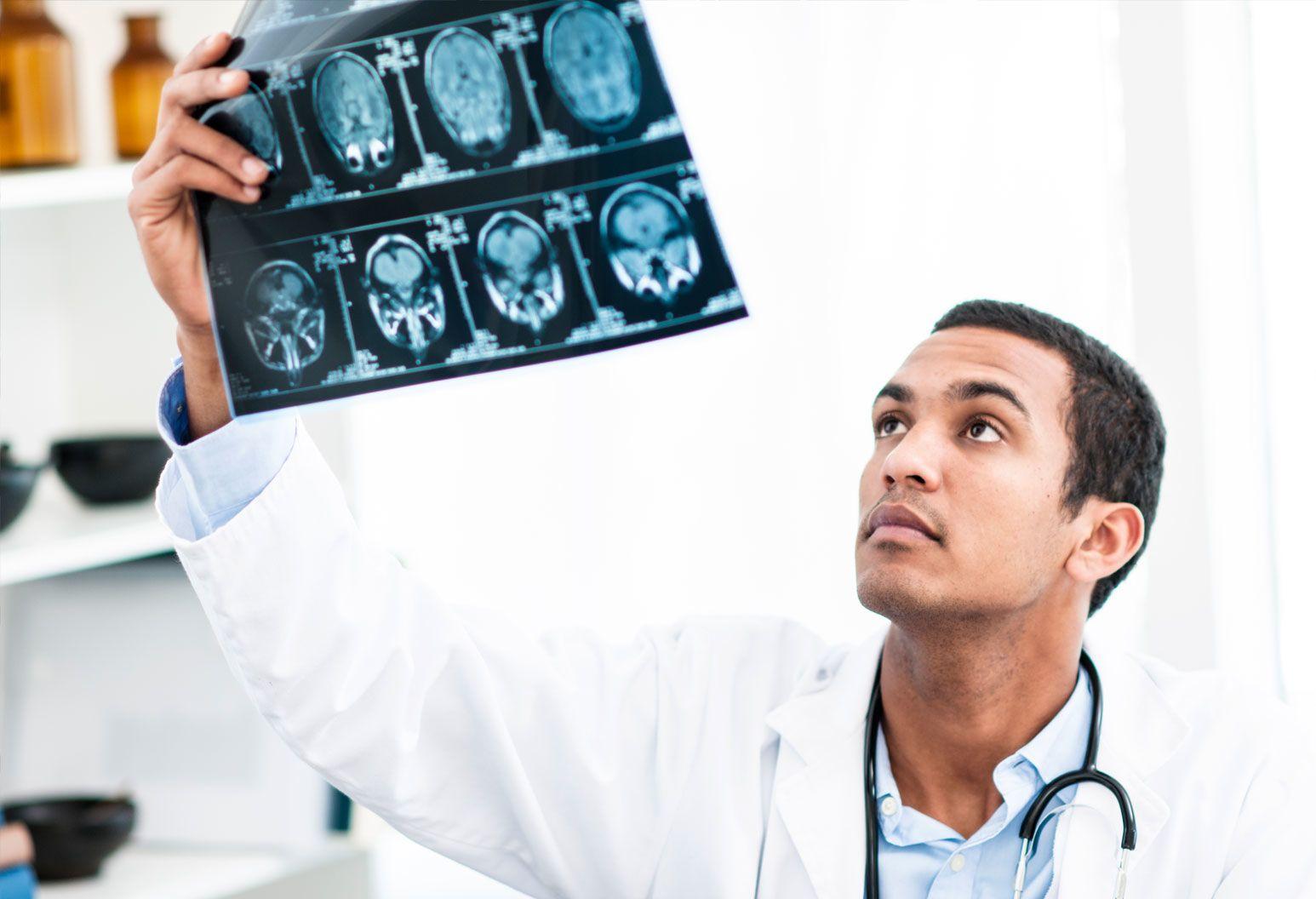 A neurologist looks at brain scans