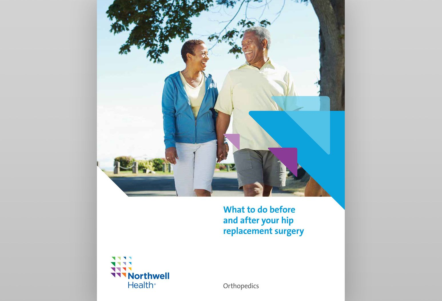 On the cover of a booklet about what to do before and after your hip surgery, there is an elderly couple holding hands and smiling at each other. They are walking outside and a tree is in the background.