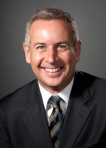 Warren Licht, MD, wearing a blue and gold tie