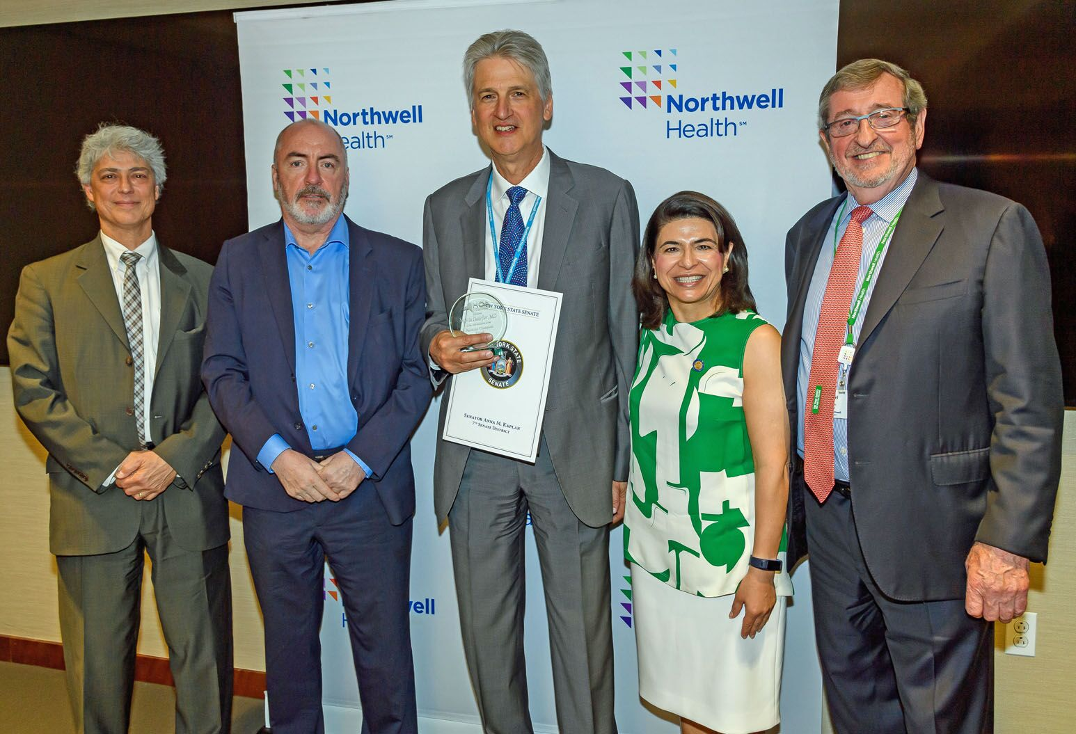 Standing in front of a Northwell backdrop (left to right): Al Cardillo, HCA president and CEO, Ciaran Staunton, Martin Doerfler, MD, Sen. Anna Kaplan and Northwell President and CEO Michael Dowling