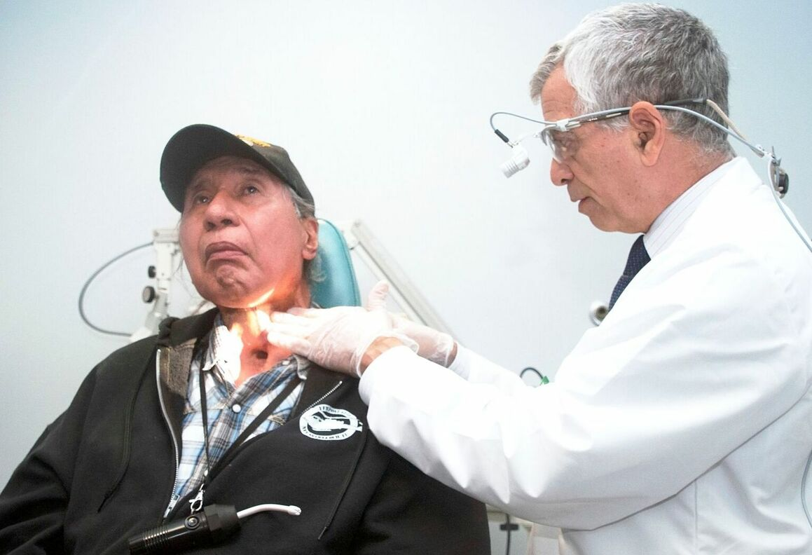 Dr. Har-El examines Mr. Isaacs at a follow-up visit after Wookey flap procedure is completed