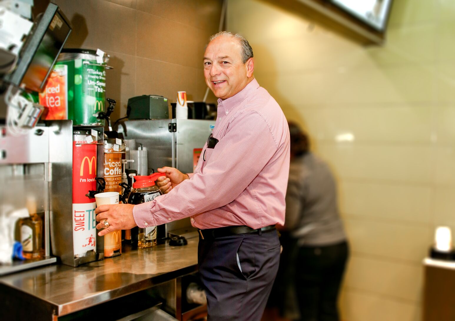 Gerald Laurino serving coffee at his McDonald's