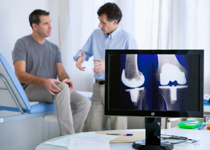 Doctor and patient discuss the knee joint