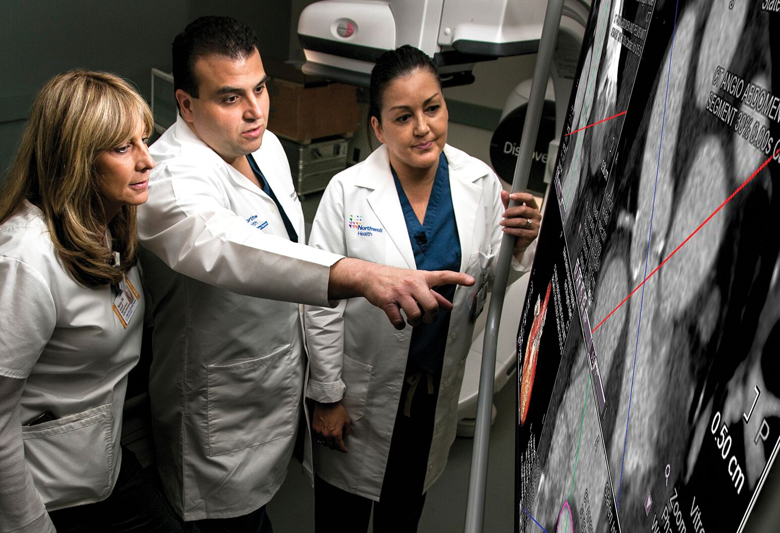 Dr. Gregory Maniatis (center) and members of the TAVR team review a case.