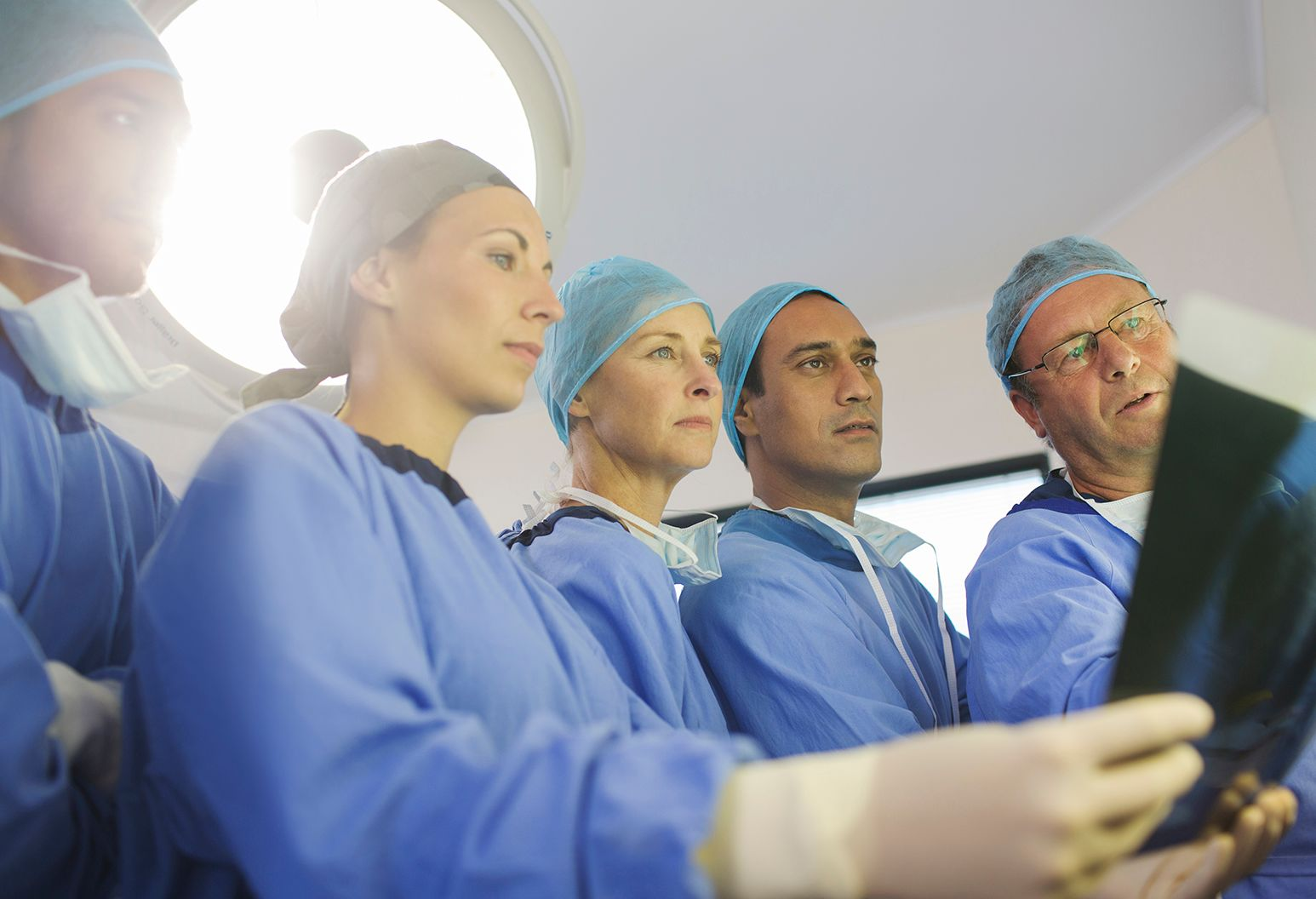 group of surgeons look at x-ray