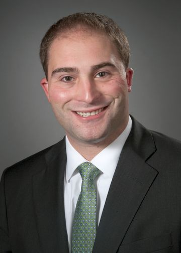 Adam Boll wearing a green tie