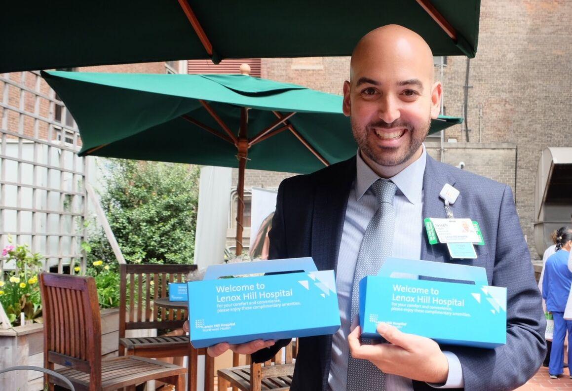 Joe Leggio, Associate Executive Director of Patient and Customer Experience , displays Lenox Hill Hospital amenity kits