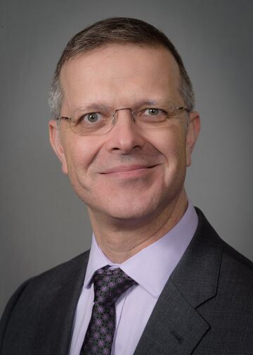 head shot of Oleg Rivkin, PA, MBA