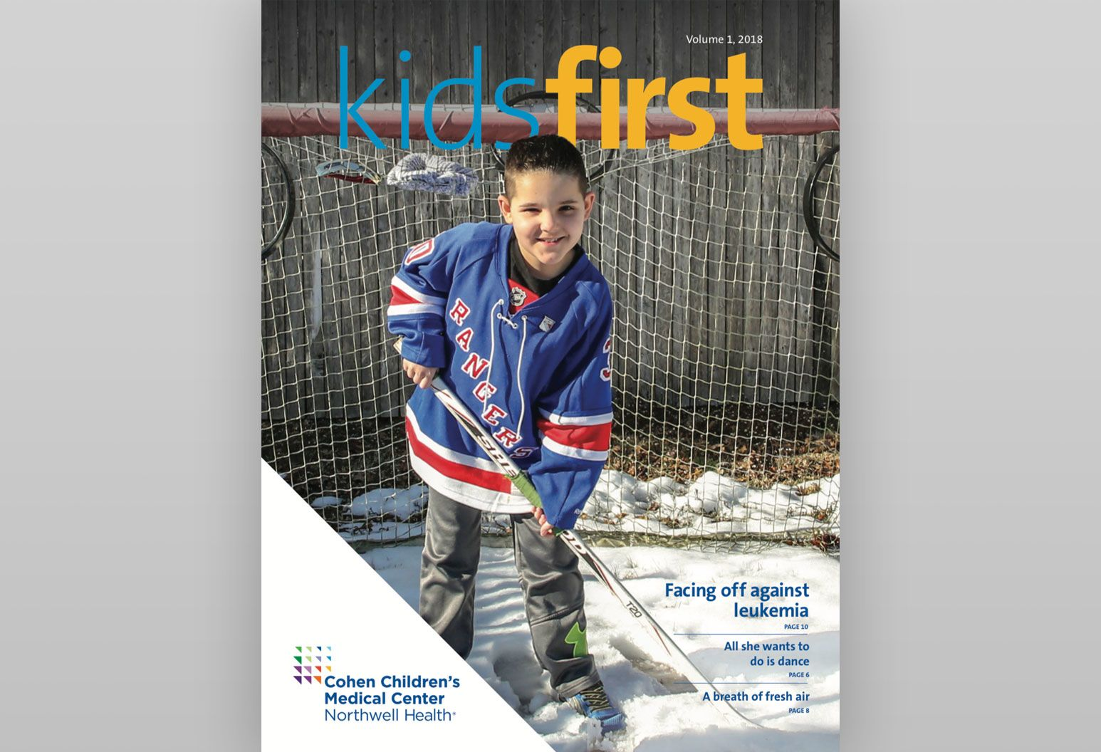 The cover of a 2018 issue of the Kids First pediatric newsletter features a young boy playing hockey
