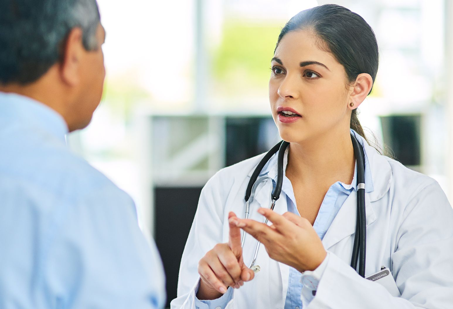 Female physician consulting with male patient