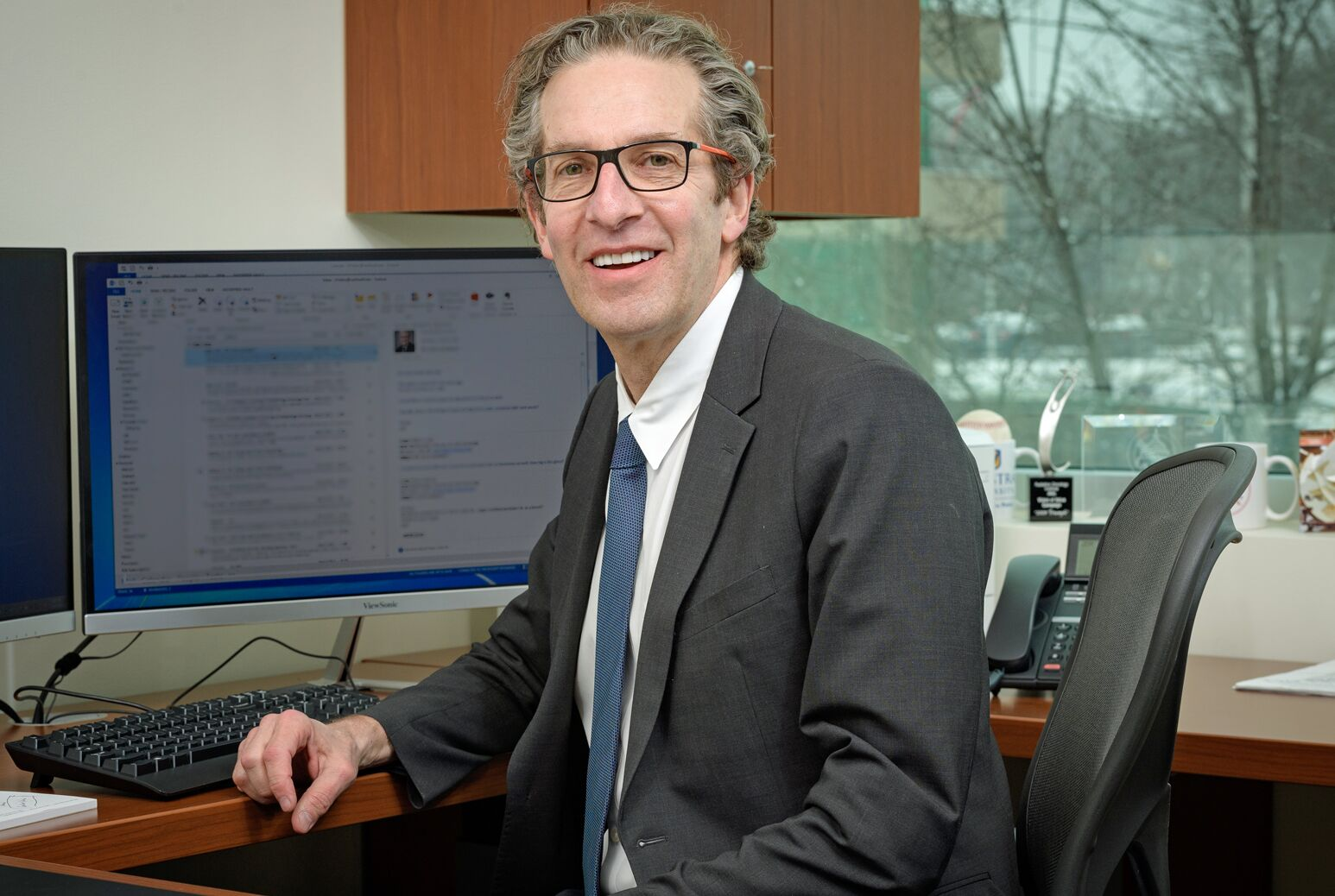 Louis Potters at his desk. Dr. Potters is leading radiation oncology for the Northwell Health Cancer Institute.