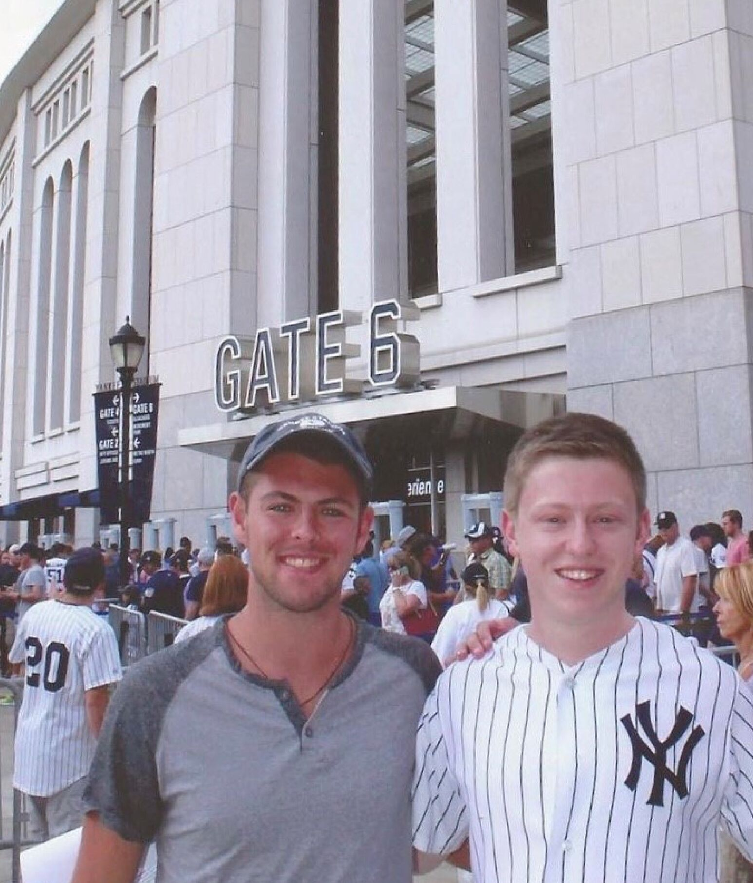 Noah and his friend, Ryan, standing outside Yankee stadium.