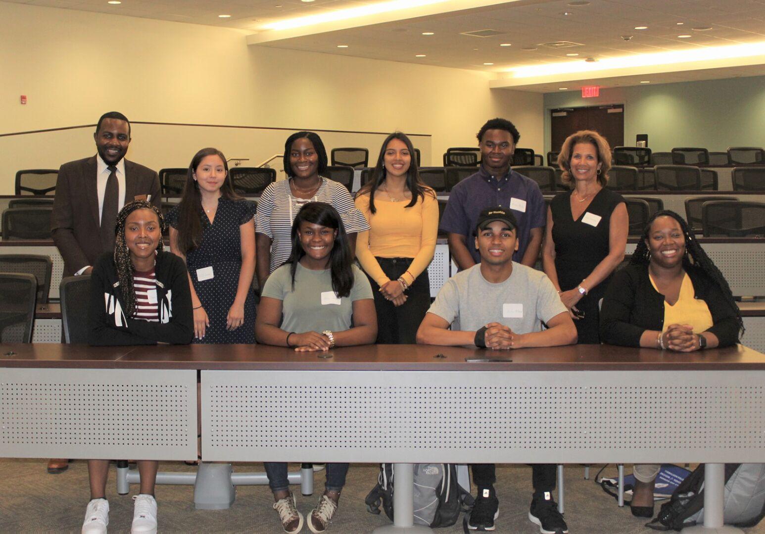 Back row, from left: Dr. Robert Roswell, associate dean of diversity and inclusion, Kelly Centeno, Tonge Enoh, Giselle Molina, Arthur Registre, Gina Granger, program director. Front, from left: Ijeoma Nnadi, Alea Jones, Julian McDonald, Lindsey Johnson.