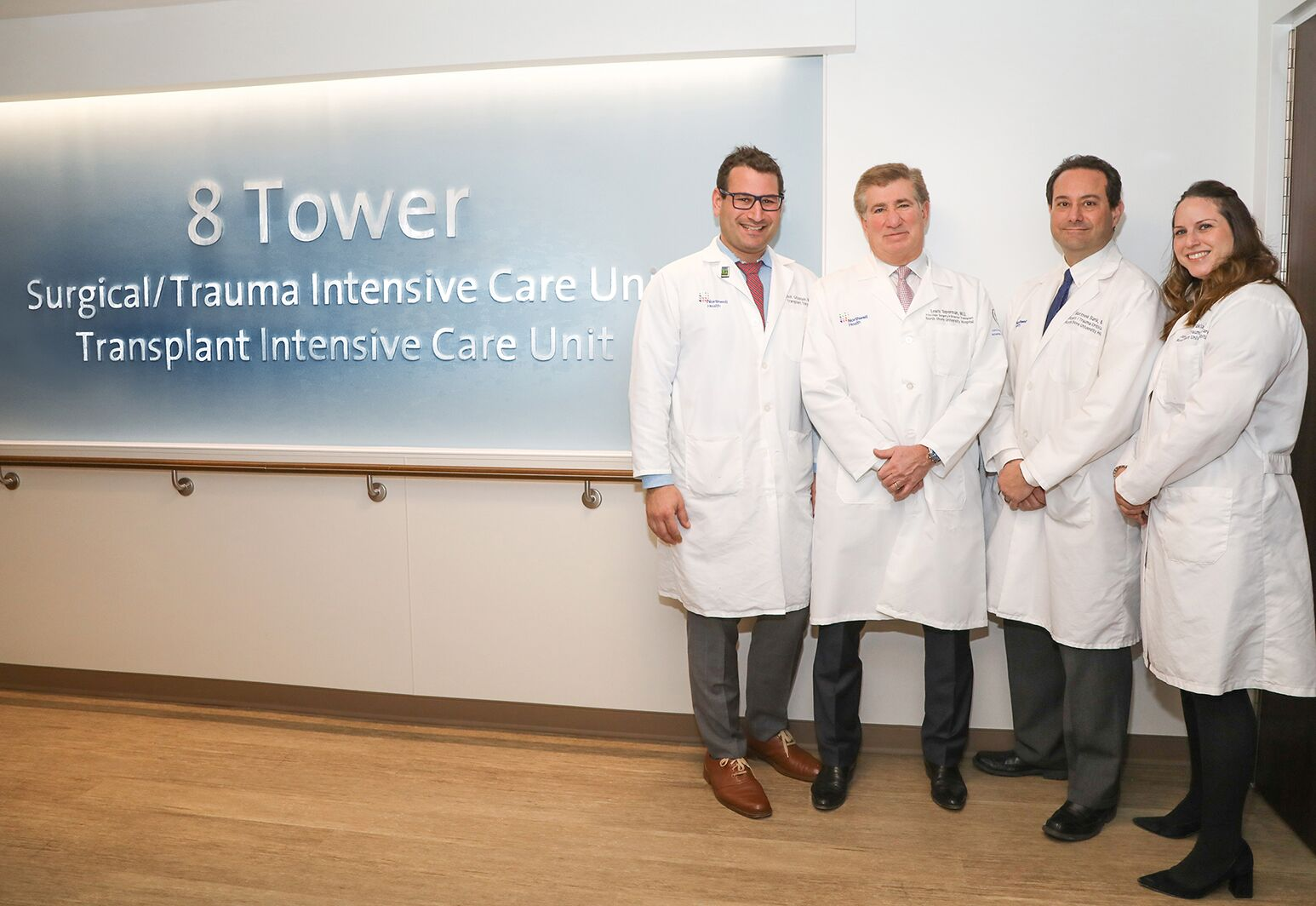 From left: Drs. Elliot Grodstein, Lewis Teperman, Matthew Bank and Maria Sfakianos at the entrance to the new Surgical and Transplant ICU at North Shore University Hospital.