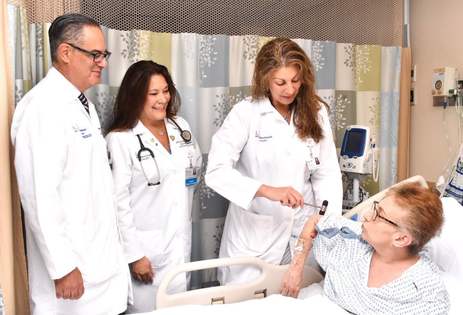 From left: Robert Duarte, MD; Maria Giraldo-Sorrentino, NP, and Mary Milano Carter, NP, conduct pain consultation with patient who received spine surgery.
