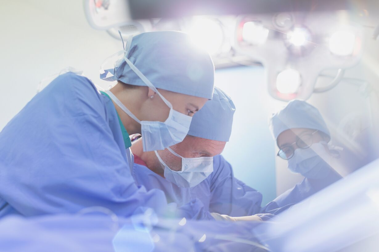 Focused surgeons performing surgery in operating room