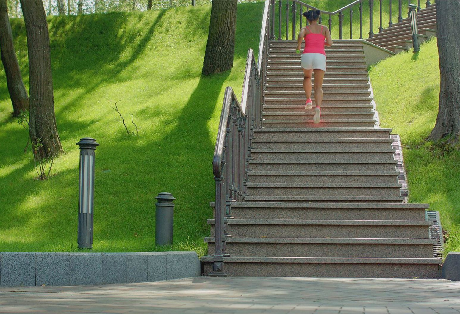Woman jogging up steps