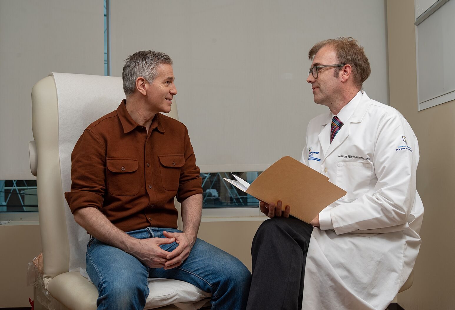 Martin Niethammer, MD, PhD, with a patient suffering from essential tremor