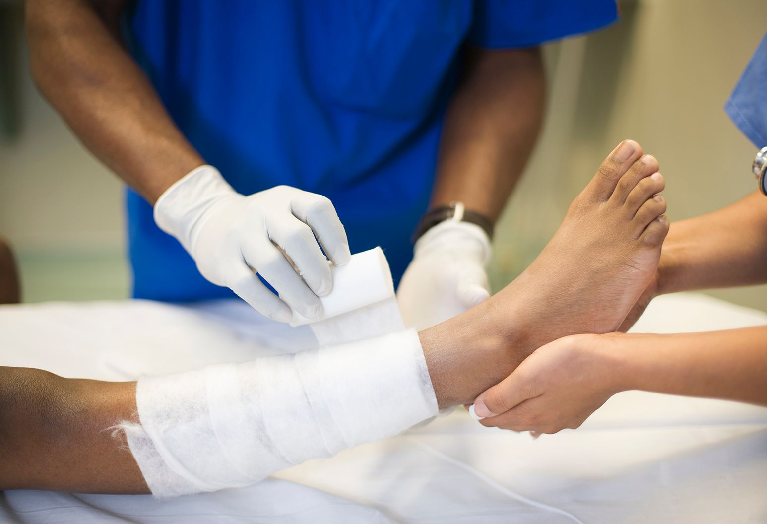 Doctor bandages patients ankle