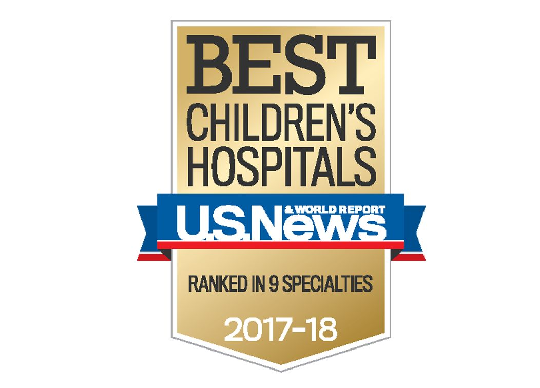"A brown badge and blue and red ribbon that reads ""Best Children's Hospitals. U.S. News and World Report. Ranked in 9 Specialties. 2017-18"""