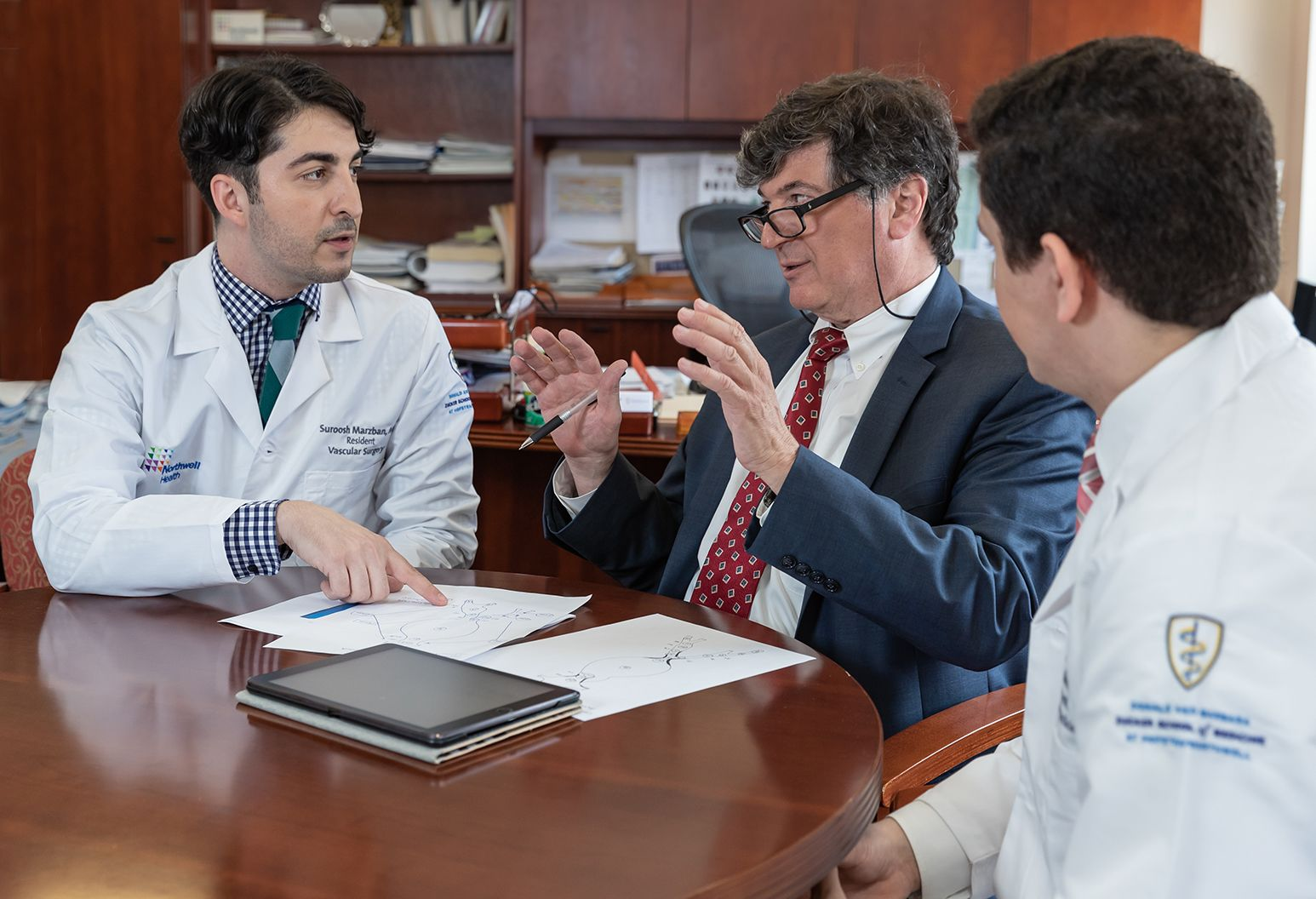 Group of physicians talking around a table