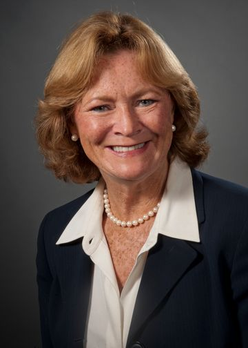 Marybeth McManus, RN, wearing a suit and white shirt