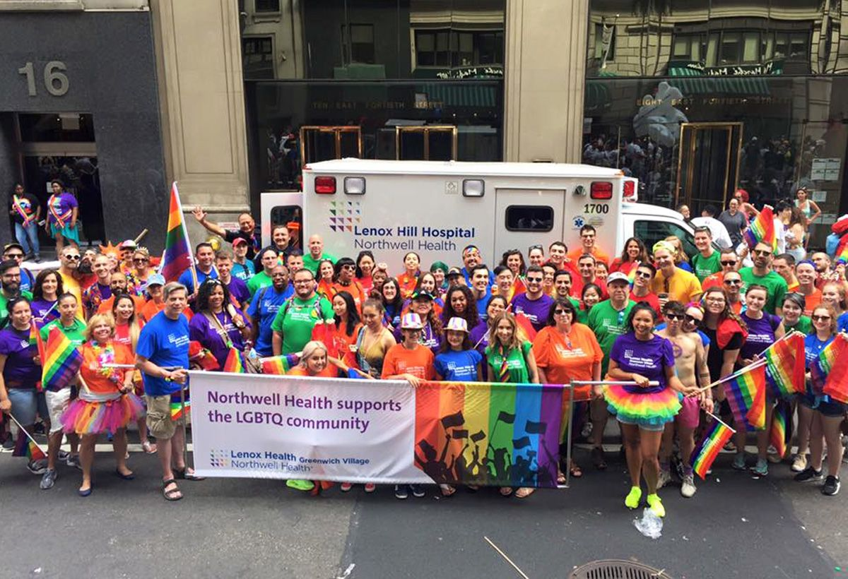Northwell supporting a Pride event with a parade banner.