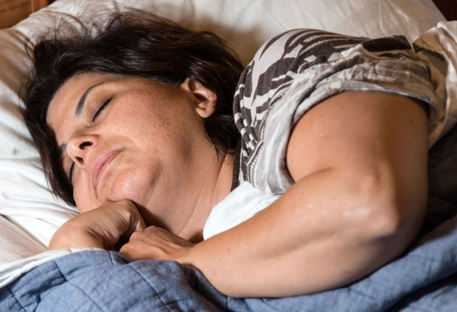 Woman with brown hair sleeping