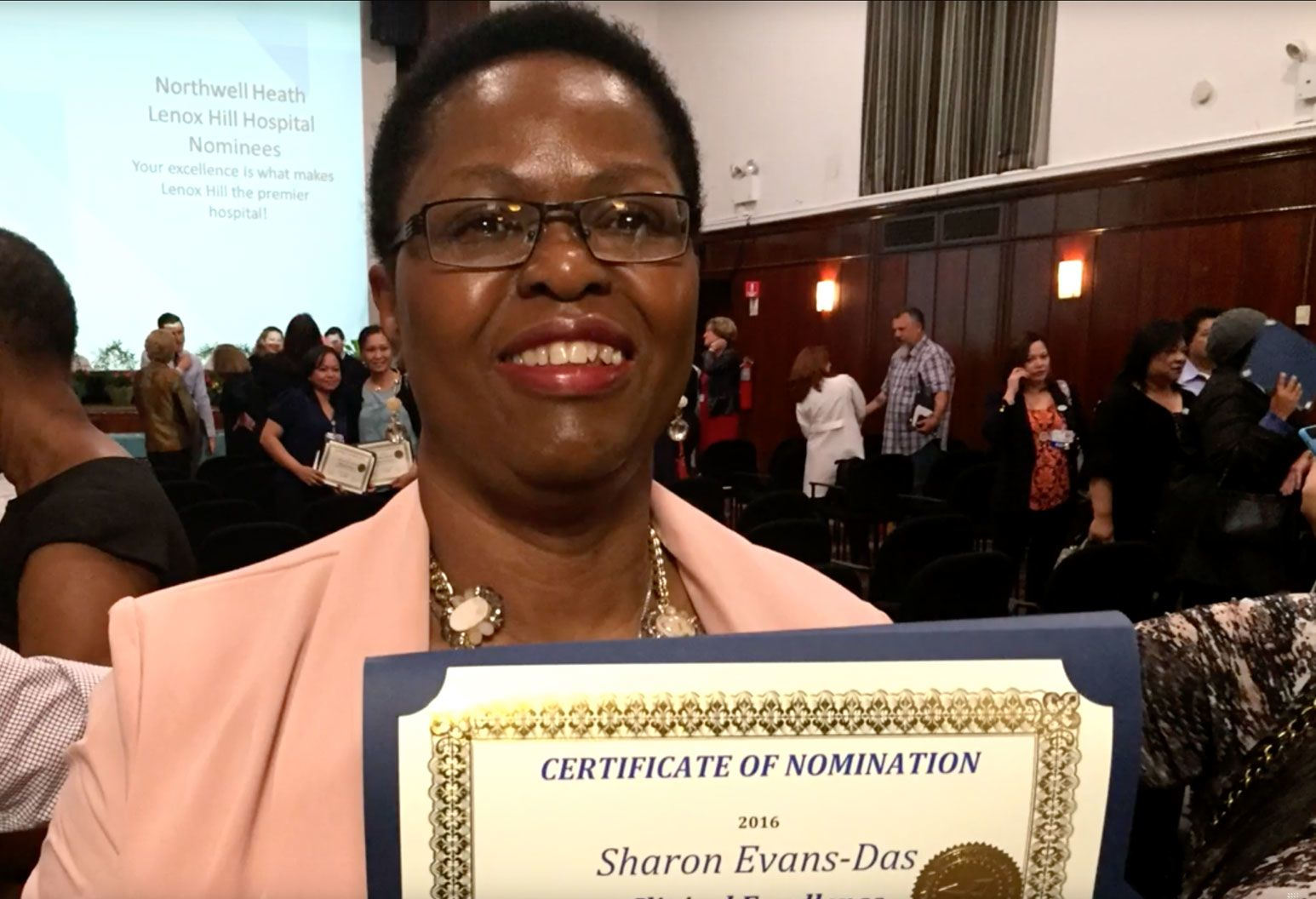 Sharon holding a certificate of nomination at a Northwell event