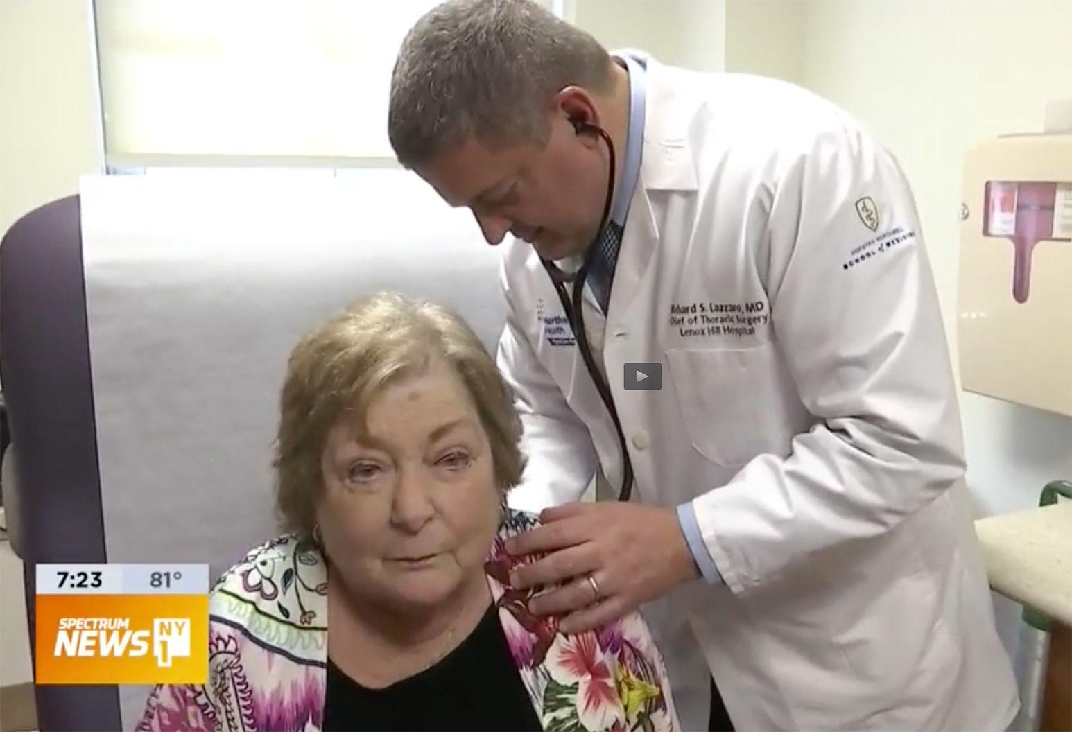 Dr. Lazzaro examining patient