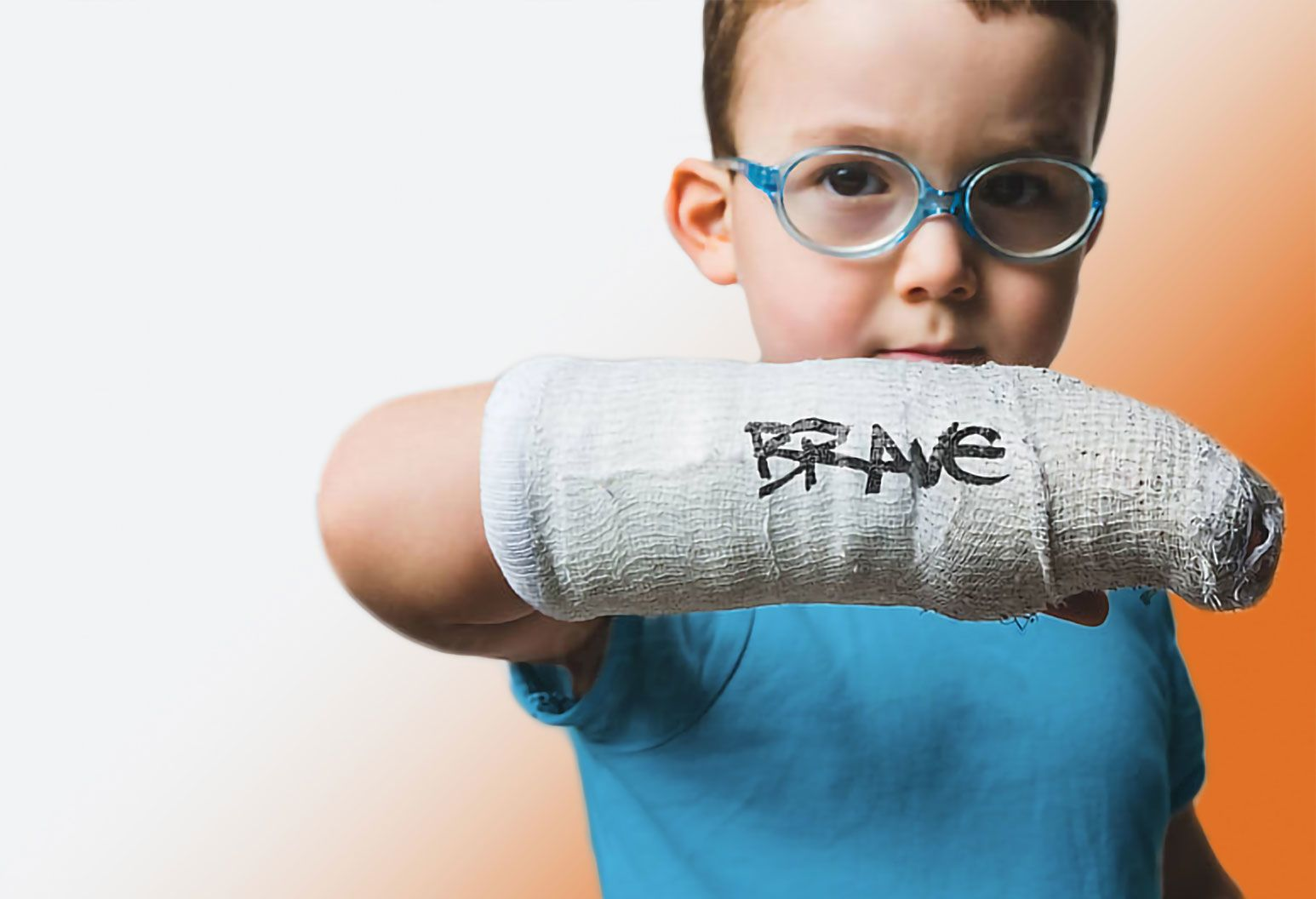 a young boy shows off his courageous injury, proving he his brave