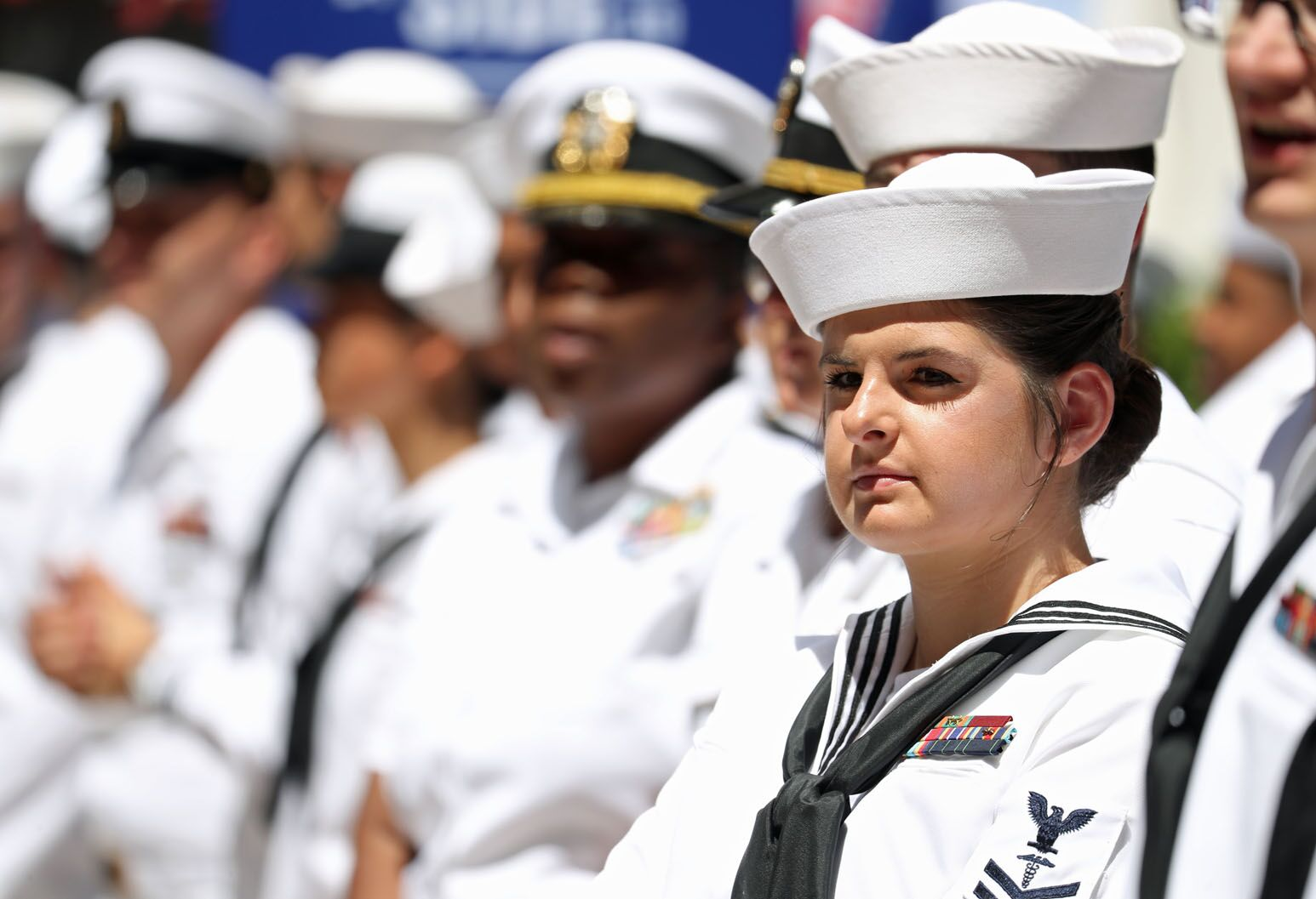 A female sailor stands in line with her colleagues during Northwell's Side by Side: A Celebration of Service™