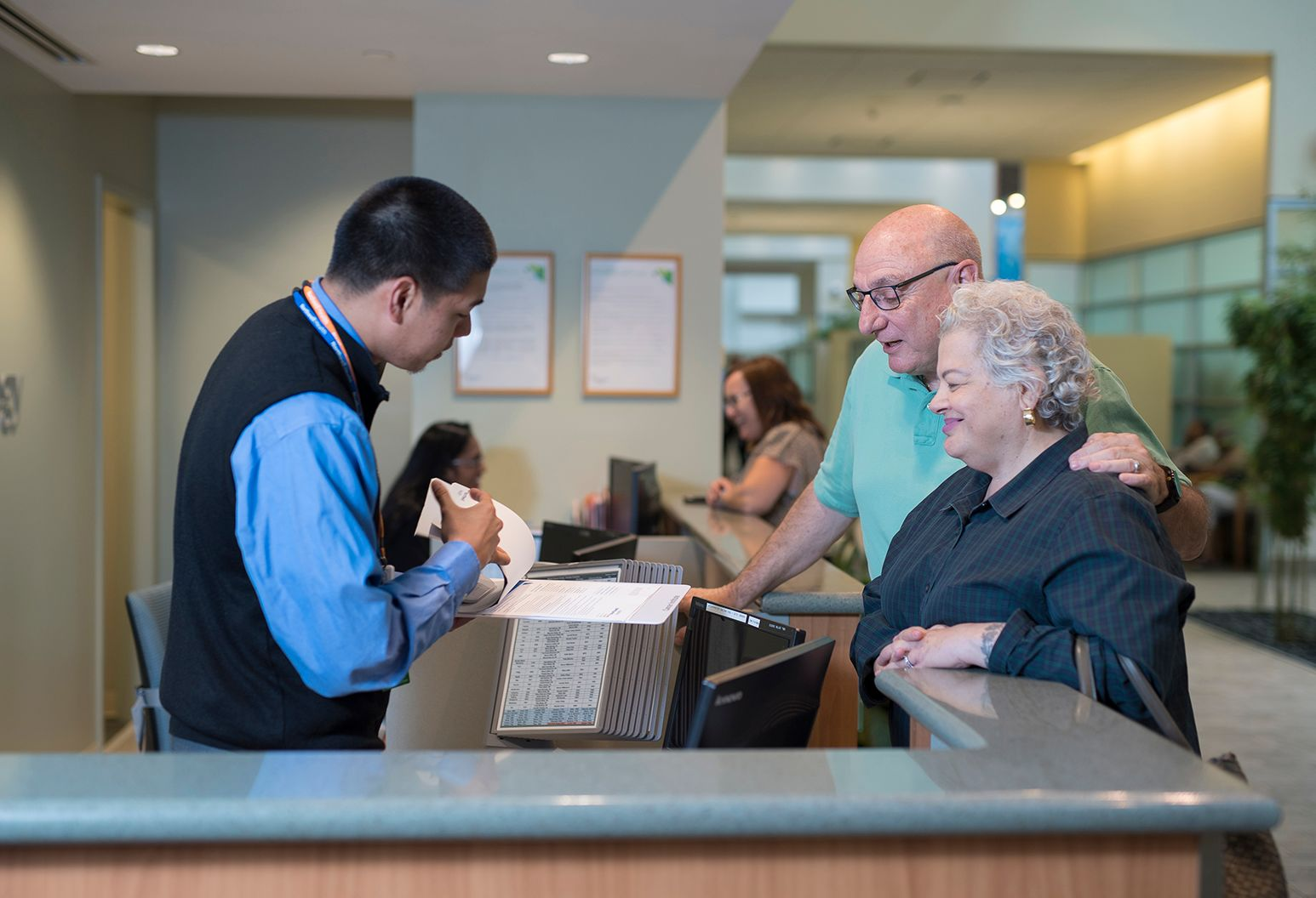 Senior couple checking in at an imaging facility.